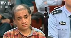 Uighur academic Ilham Tohti sits during his trial on separatism charges in Urumqi, Xinjiang region